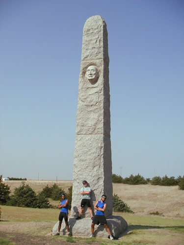 Rajeev, Brent, and Mark pose by the Massacre Valley Monument near Trenton, NE.