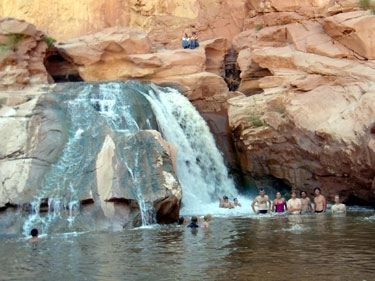 showering in a waterfall 7 miles from our capitol reef campsite